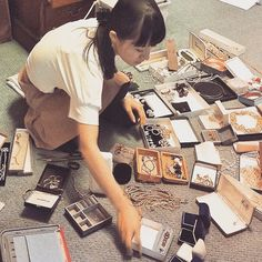 Marie Kondo organizing items on the floor